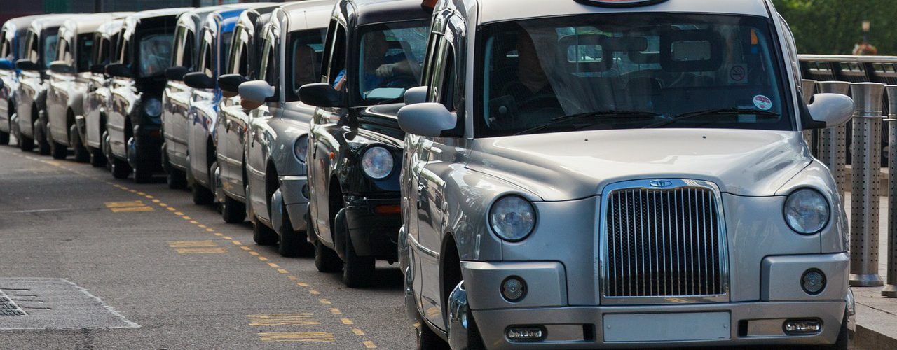 Guaranteed hire vehicle for taxis, taxi queue